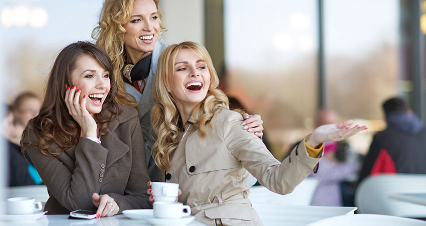 Laughing friends in the cofee shop