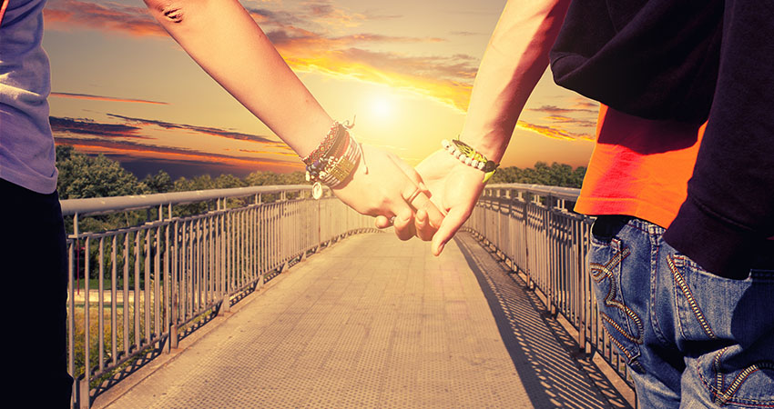 Lovers couple holding hands
