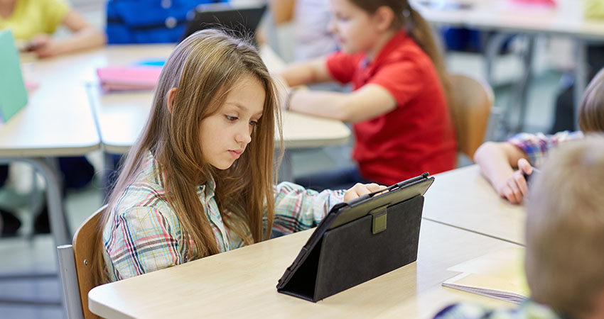 school kids with tablet pc in classroom