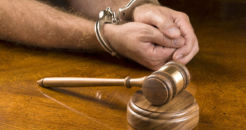 Arrested man and gavel